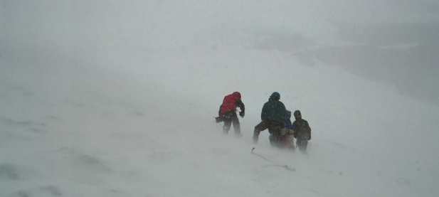 A group of climbers struggling through a blizzard.