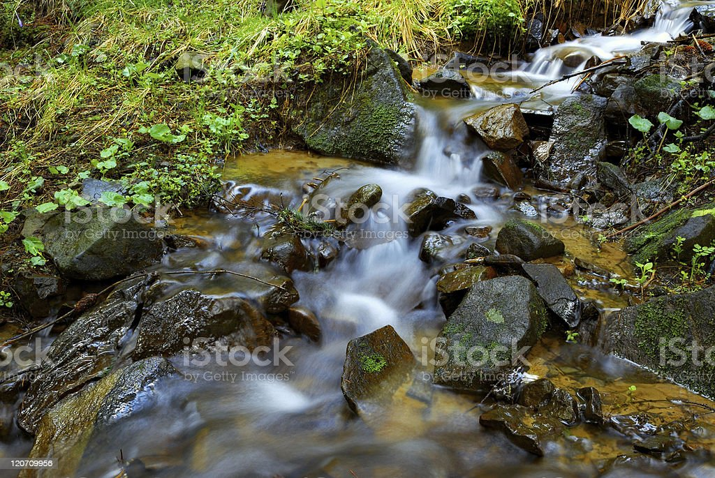 mountain stream and mossy stones stock photo