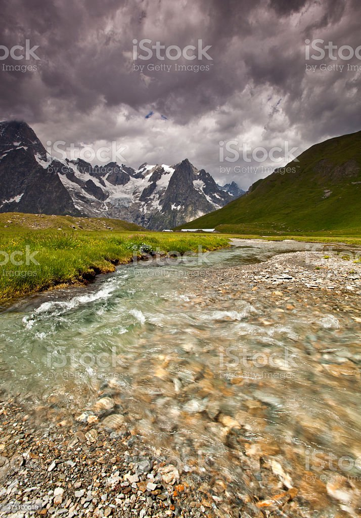 Mountain Stream, Mont Blanc Massif, Threatening sky, Val Ferret, Italy stock photo