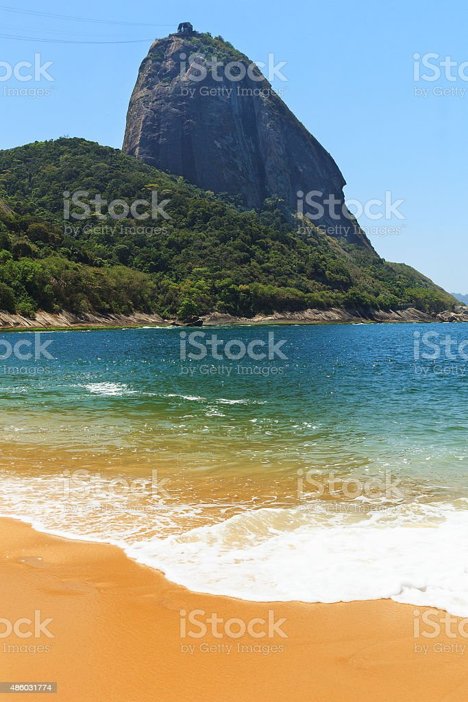 Mountain Sugarloaf, empty red beach blue sea, Rio de Janeiro, stock photo