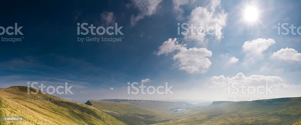 Mountain sunburst wilderness valley stock photo