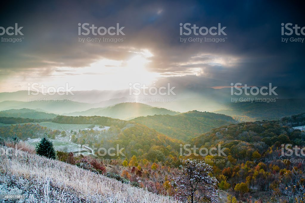 Mountain sunrise autumn with winter snow stock photo