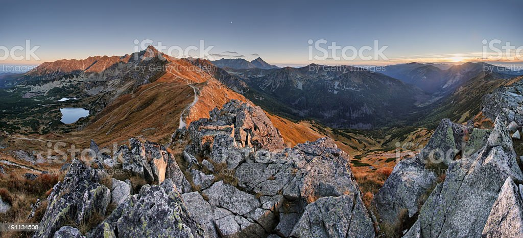 Mountain sunset panorama from peak - Poland Tatras stock photo