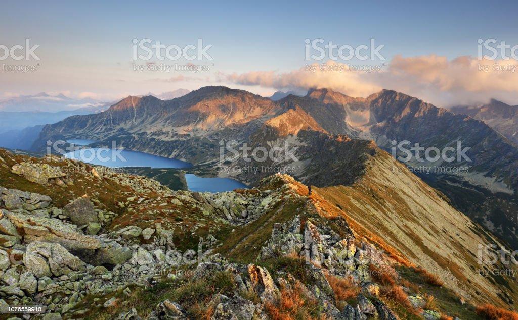 Mountain sunset panorama from peak - Slovakia Tatras Mountain sunset panorama from peak - Slovakia Tatras Adventure Stock Photo