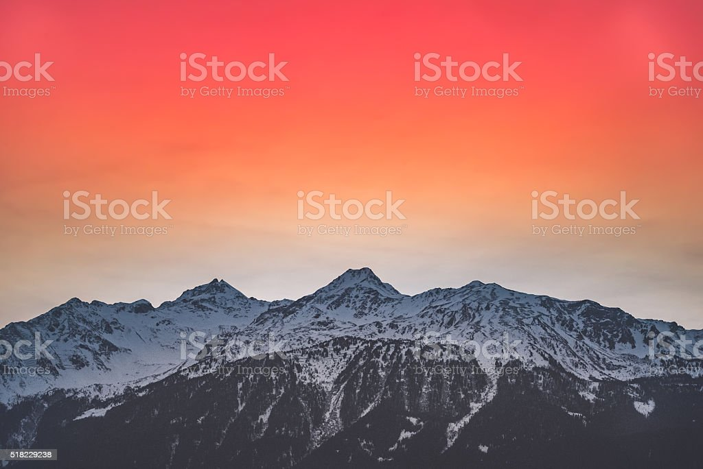 Mountain sunset with red sky stock photo