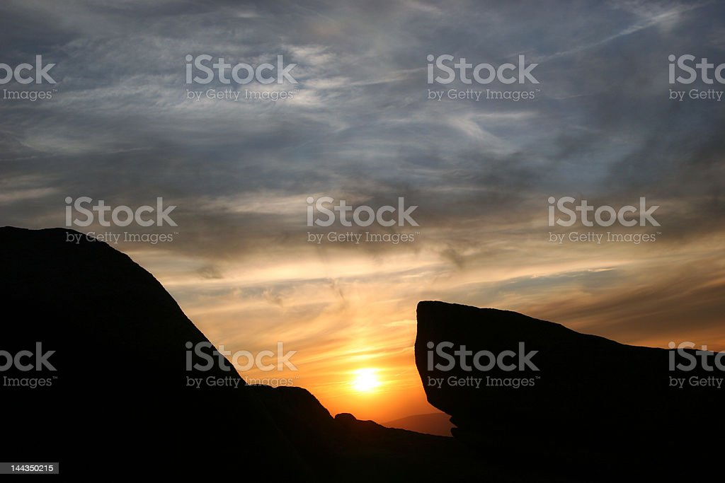 Mountain sunset with rock shape royalty-free stock photo