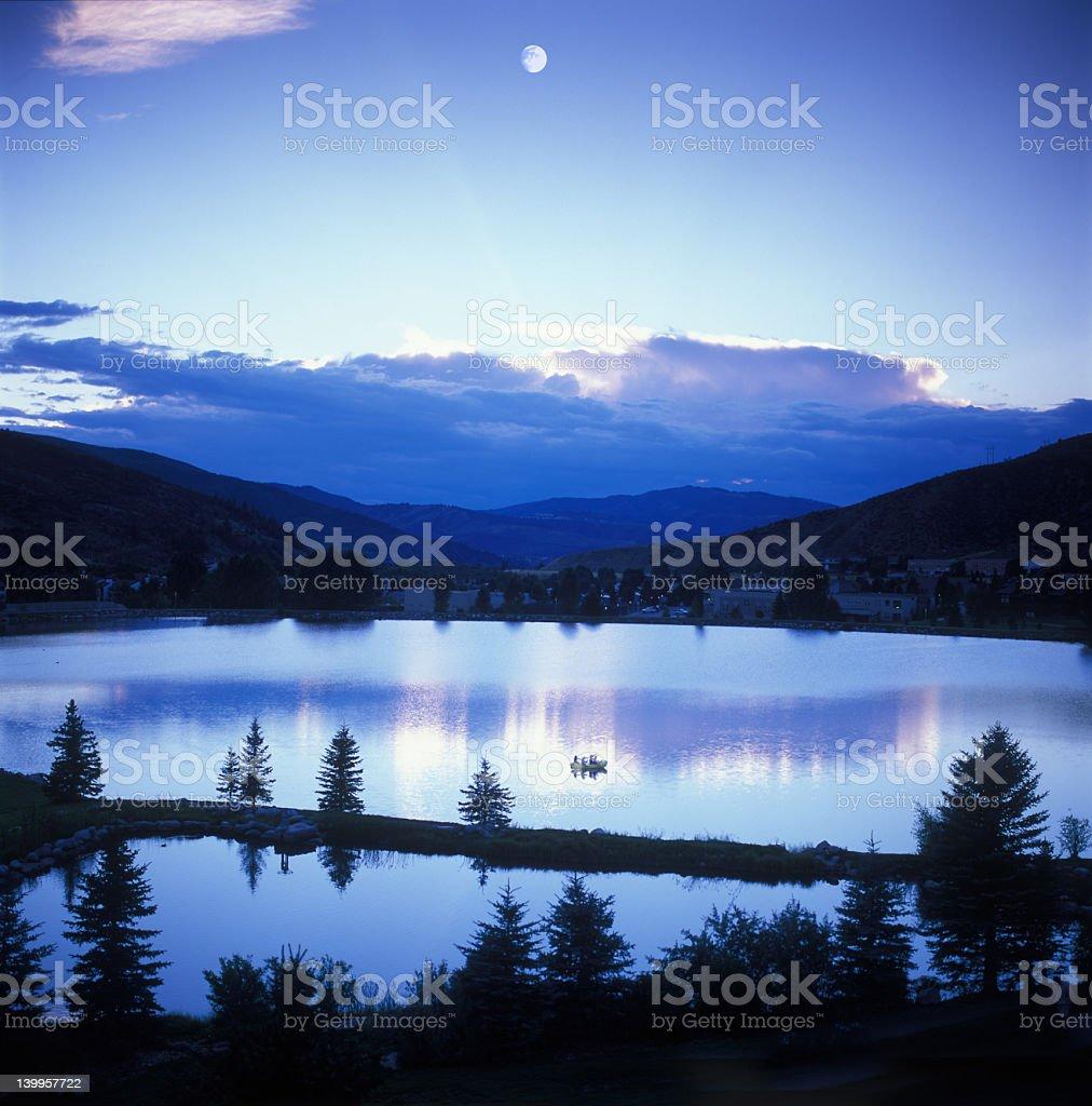Mountain sunset/moonset stock photo