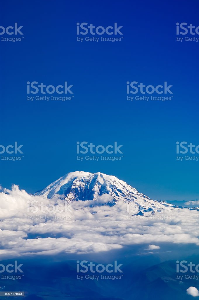 Mountain Top Above Clouds with Blue Sky stock photo