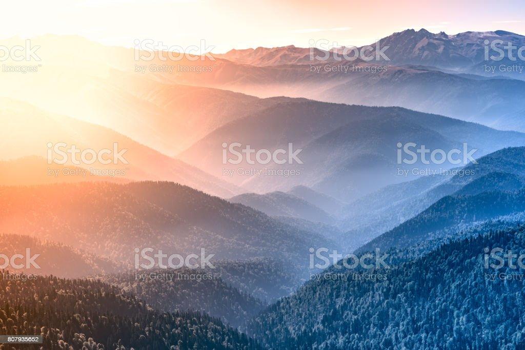 Mountain tops at autumn morning time. stock photo