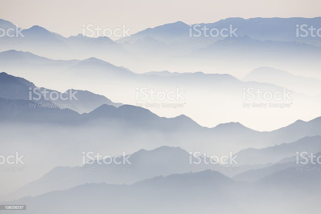 Mountain Tops in Clouds stock photo