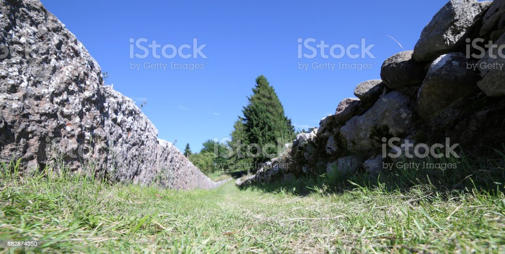 mountain trail used as a mule track bordered by stone slabs stock photo