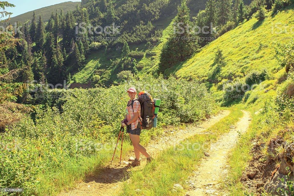 Mountain trekking trip woman stock photo