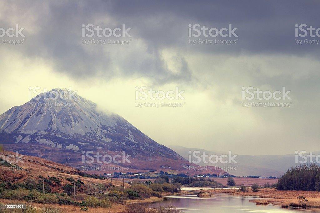 Mountain under dark clouds. stock photo