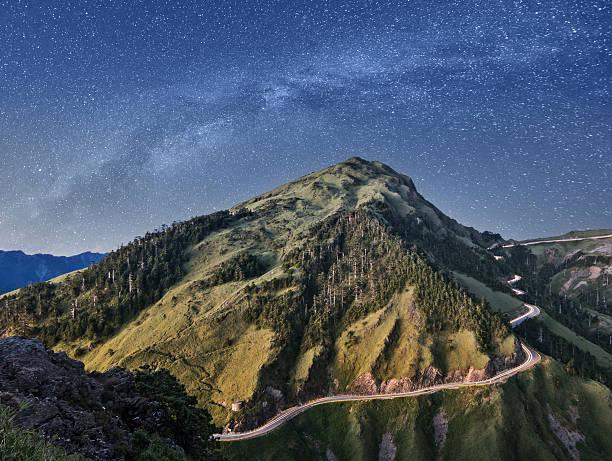 mountain under stars stock photo