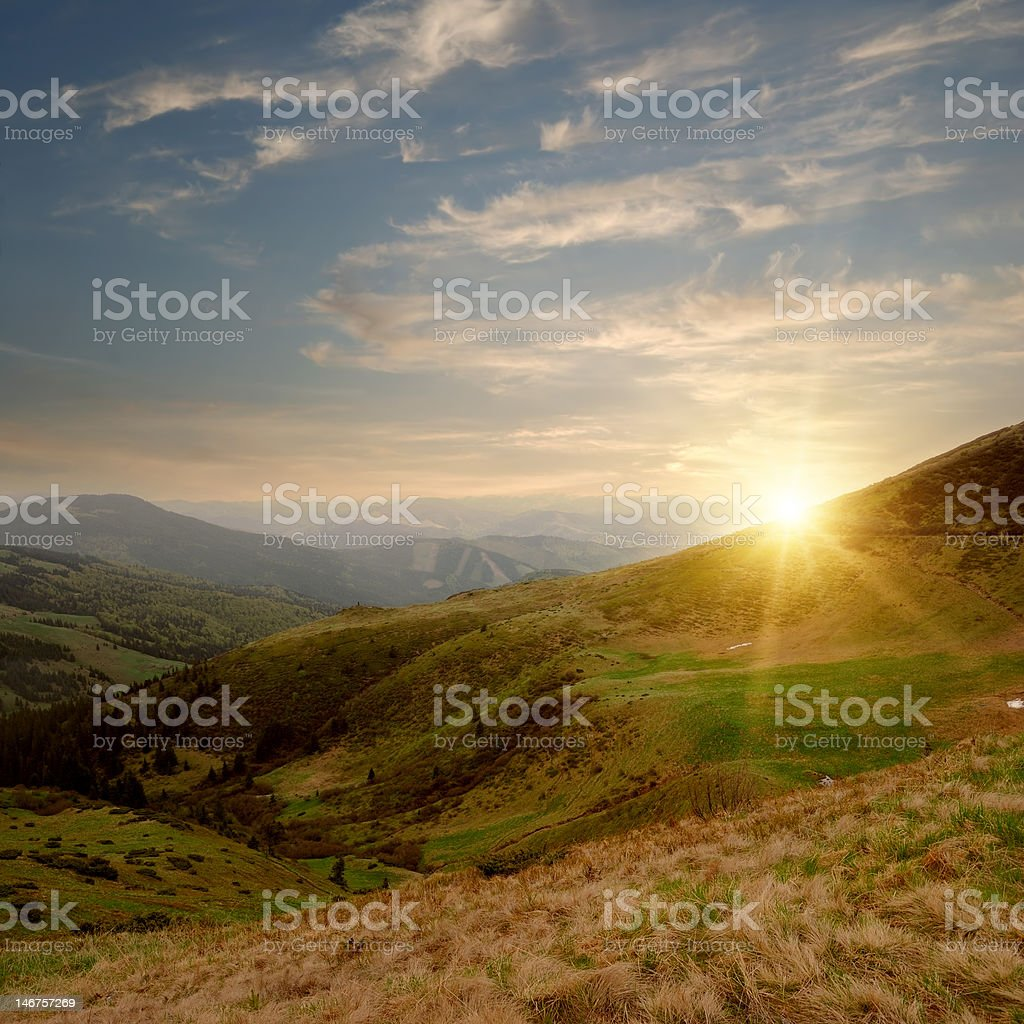 mountain valley and sunset royalty-free stock photo