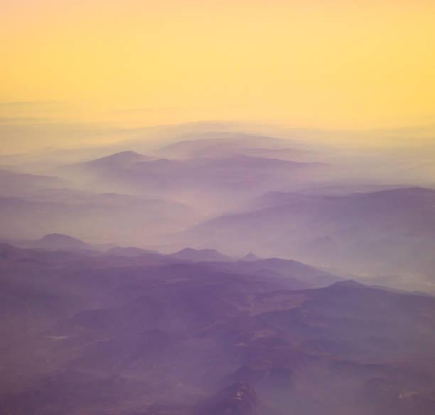 bergsdal i pastellfärger - earth from space bildbanksfoton och bilder