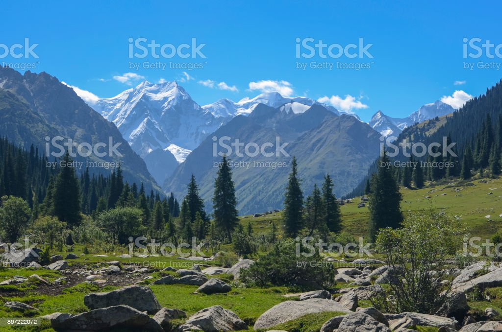 Mountain valley in picturesque mountains in Tian Shan mountain, Karakol, Kyrgyzstan, Central Asia. Sunny meadow in the valley Jety-Oguz, Altyn Arashan Mountain stock photo