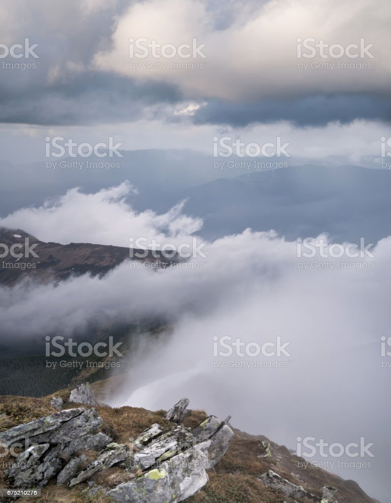 Mountain valley in the clouds. Natural summer landscape royalty-free stock photo