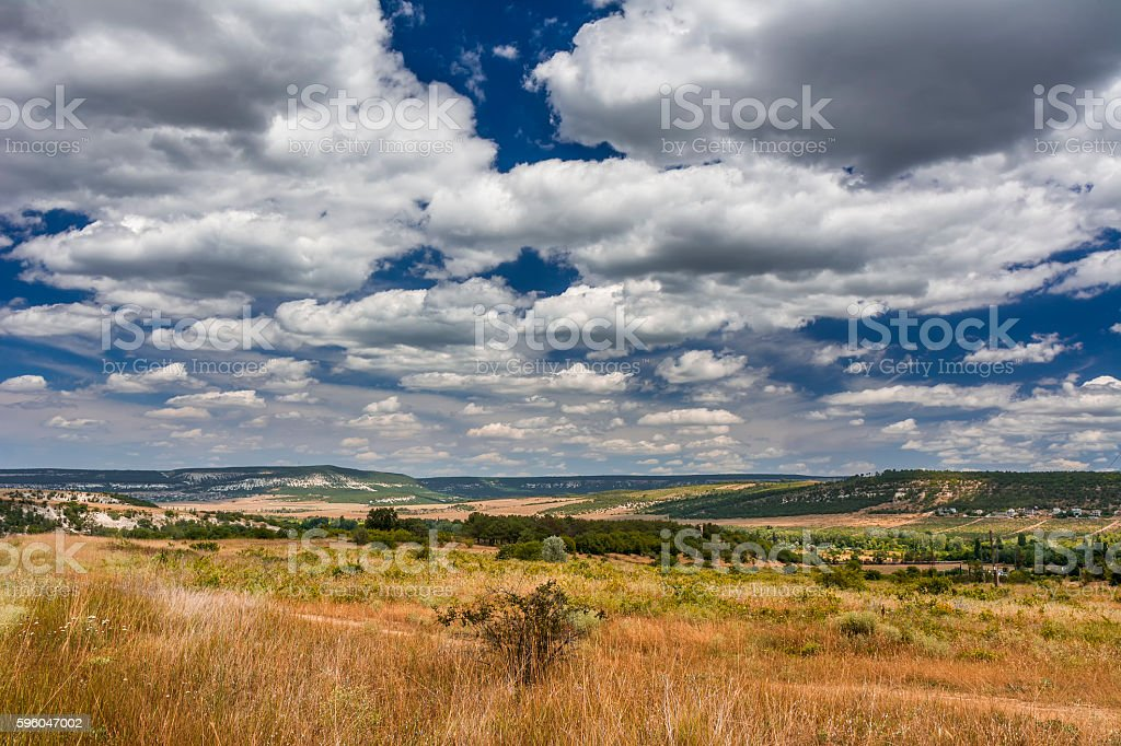 Mountain valley with a cloudy sky. Natural summer landscape. royalty-free stock photo