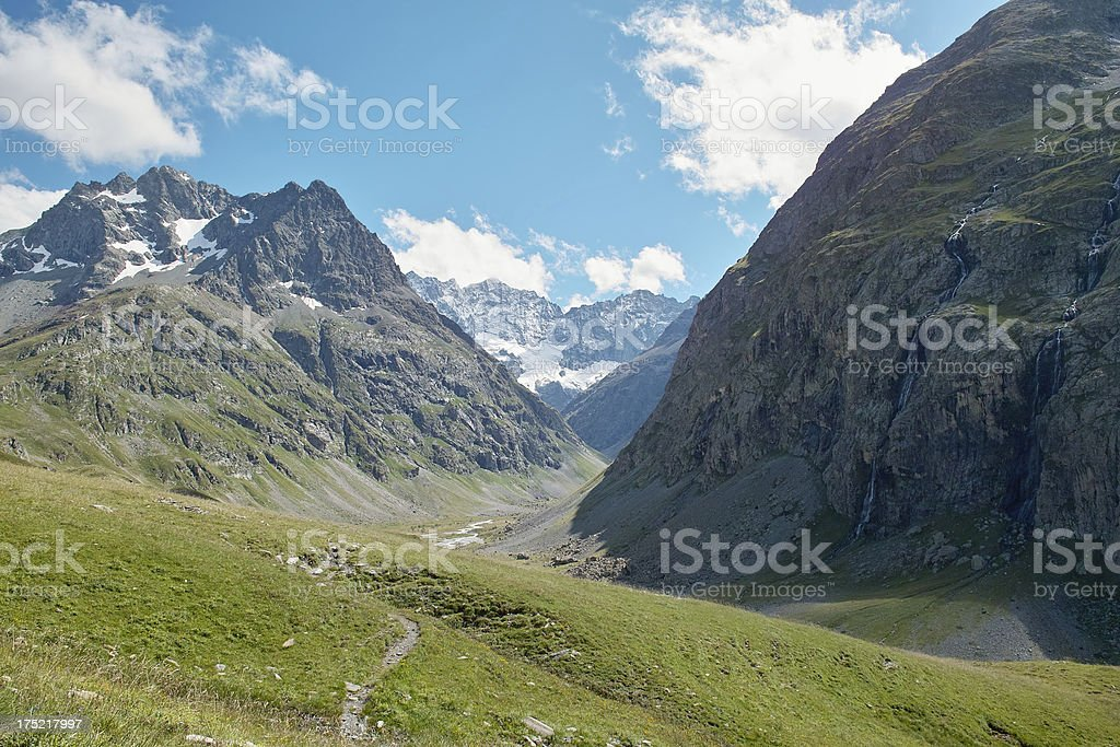 mountain valley with trail in summer stock photo