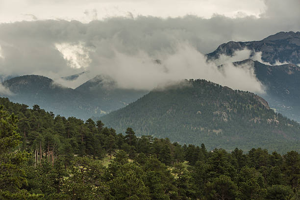 Mountain Valleys Filled with Gray and White Storm Clouds stock photo