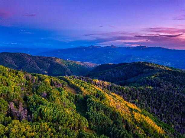 Mountain View of Beaver Creek and Sawatch Mountains Mountain View of Beaver Creek and Sawatch Mountains - Stunning sunset views with autumn fall colors and changing aspen trees. Pink clouds and mountain views. beaver creek colorado stock pictures, royalty-free photos & images