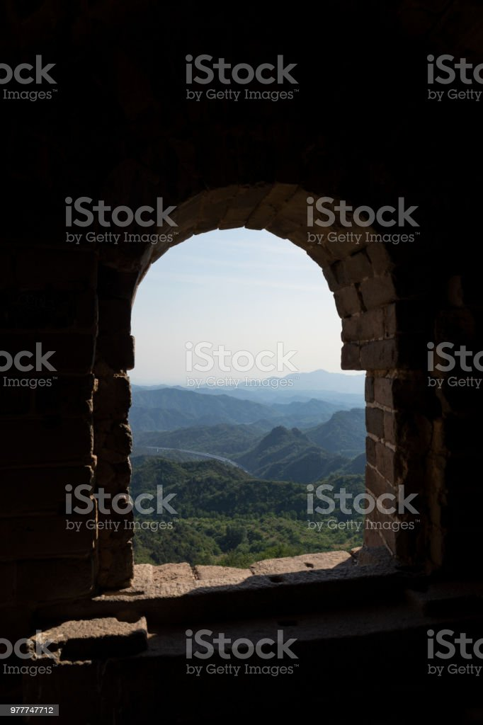 Mountain view through stone arch stock photo
