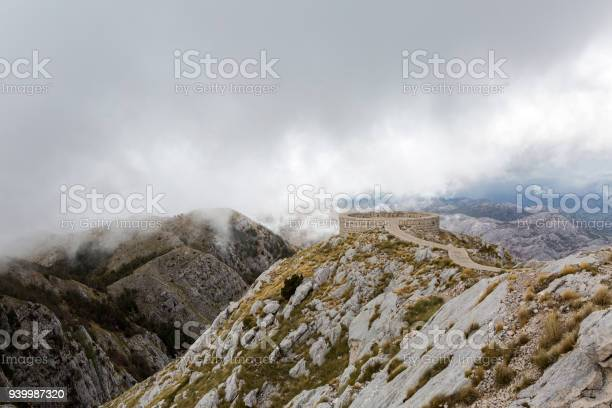 Photo of mountain view with thick clouds down to the lowland