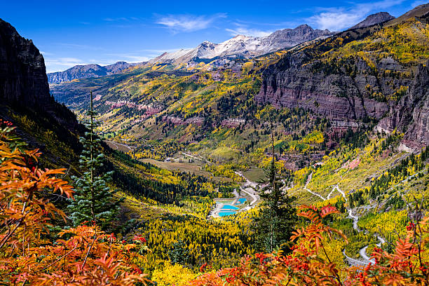 Mountain Views Looking at Town of Telluride Mountain Views Looking at Town of Telluride - Landscape scenic view from high above Telluride with views of old mine, reclamation ponds, and town with high mountains.  San Juan Mountains, Colorado USA. san juan mountains stock pictures, royalty-free photos & images