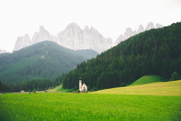 Mountain views near Santa Magdalena chruch , Val di Funes, Dolomite Alps, Italy stock photo