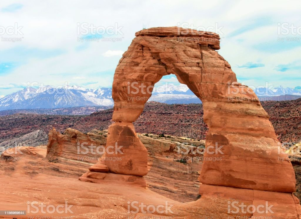 Mountain Views Mountain view through Delicate Arch, located at Arches National Park in Moab, Utah. Arches National Park Stock Photo