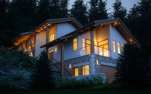 Digitally generated mountain villa at night.  The scene was rendered with photorealistic shaders and lighting in Autodesk® 3ds Max 2020 with V-Ray 5 with some post-production added.