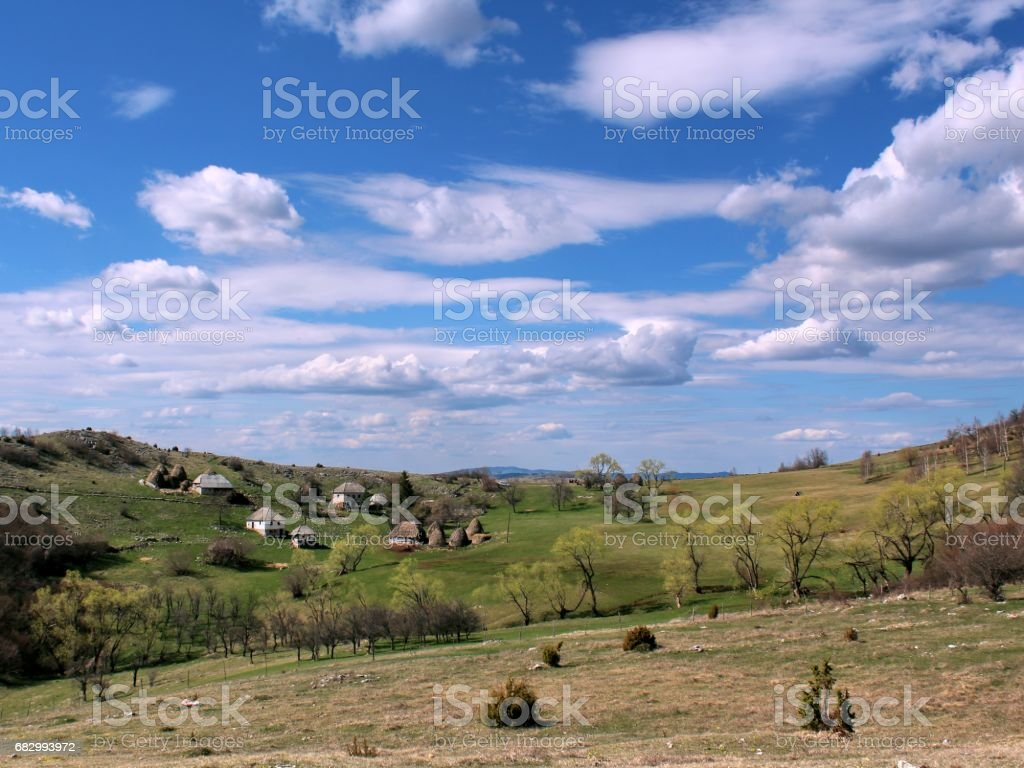 Mountain village and sky wiyh clouds royalty-free stock photo