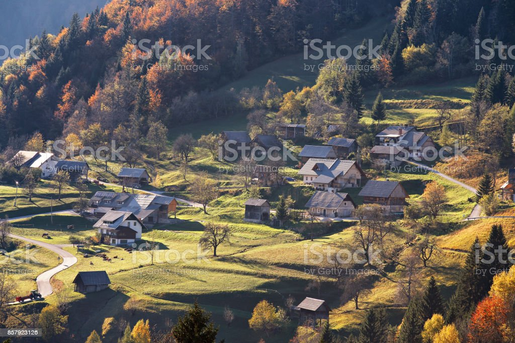 Mountain village in Alps, houses on the hills in traditional style stock photo
