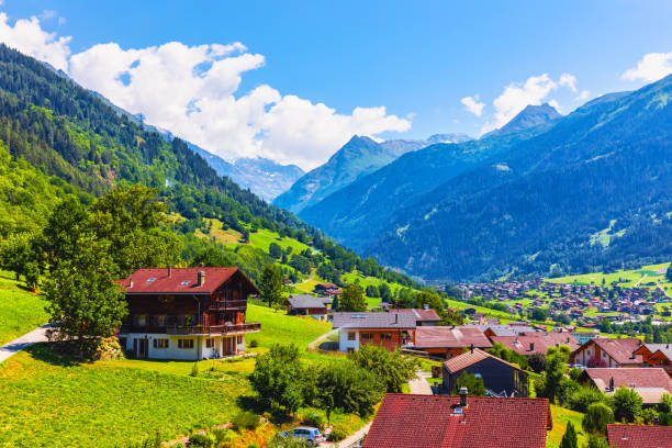 Mountain village in Alps, Switzerland Scenic summer view of wooden cottage houses in the mountain village in Alps, Switzerland switzerland stock pictures, royalty-free photos & images