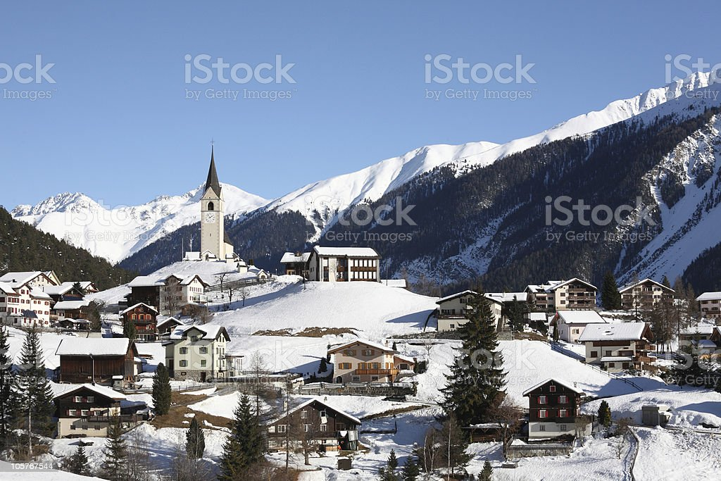 Mountain Village in Winter Alps near Davos stock photo