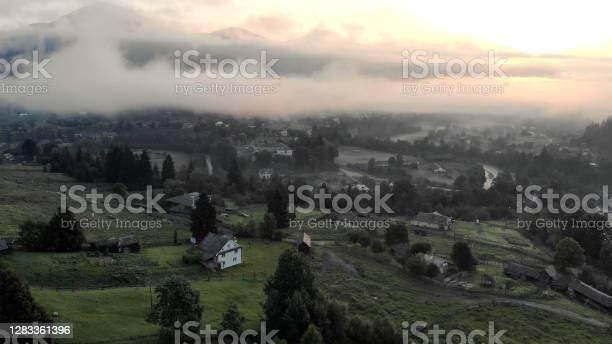 Photo of Mountain village under thick smoke.