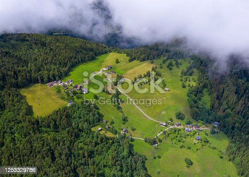 Mountain Village with Farm uncovered from clouds, Salzkammergut, Ausseerland, Austria. Converted from RAW.