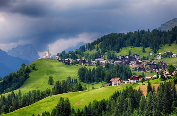 Mountain village with house in Dolomites Mountain village with house in Dolomites galicia stock pictures, royalty-free photos & images