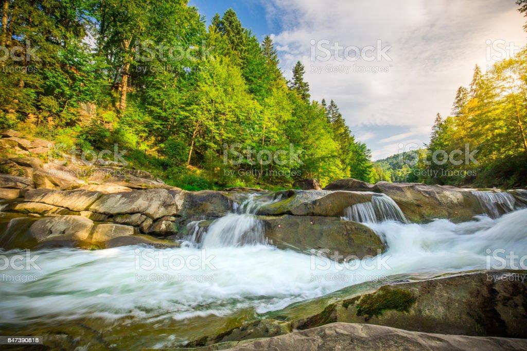 Mountain waterfall Guk in the wood. Ukrainian Carpathians. stock photo