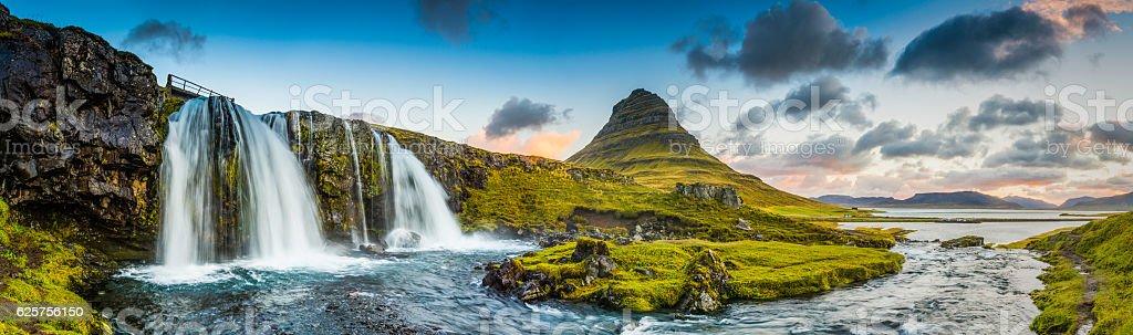 Mountain waterfalls below rocky peaks panorama at sunrise Kirkjufell Iceland stock photo