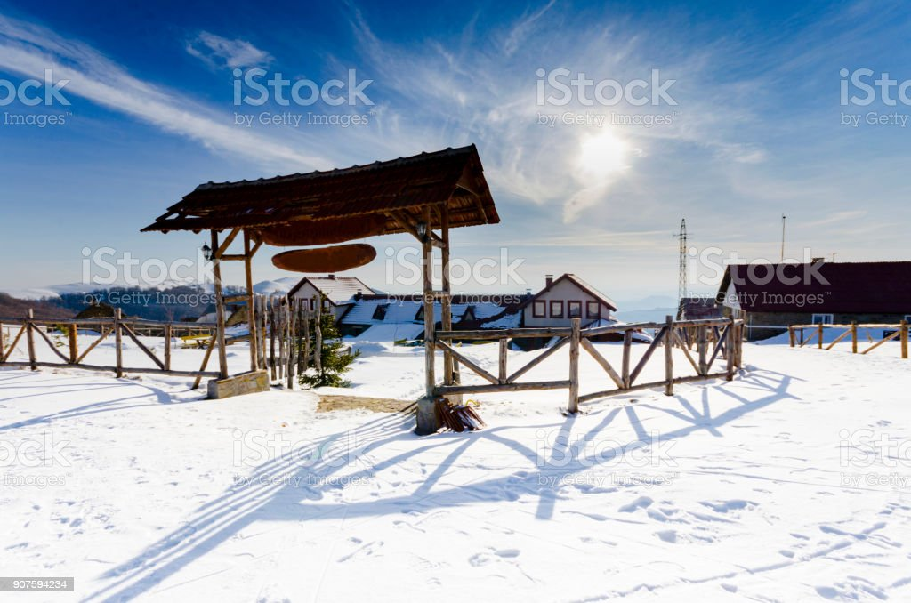 Mountain winter complex with wooden entrance door stock photo
