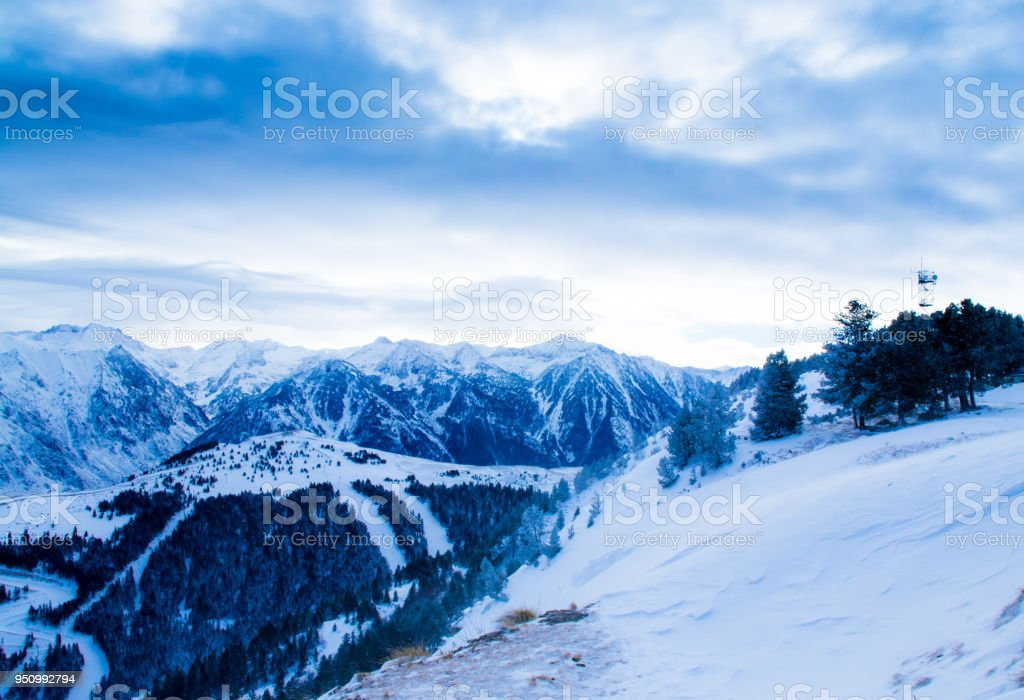 Mountain winter landscape in cold weather. The tops of the mountains...
