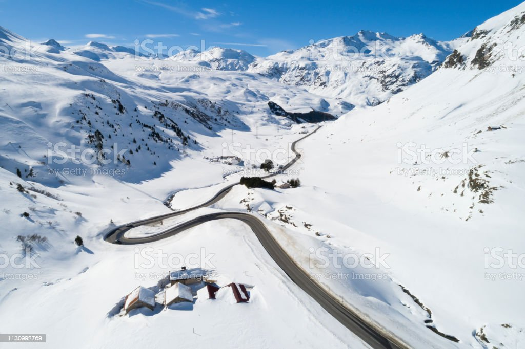 Mountain winter landsccape with winding road, aerial view, Graubunden...