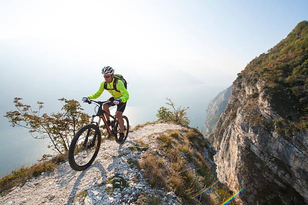 mountainbike adventure  - garda lake - mountain biking stock photos and pictures