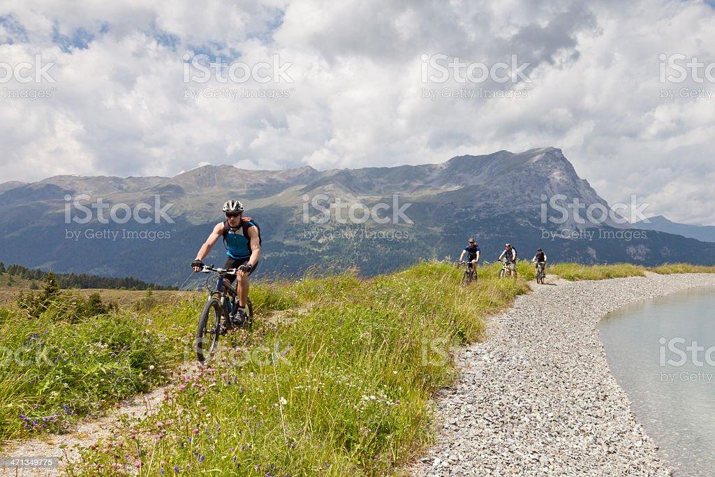 Mountainbike along the pond, South Tyrol stock photo