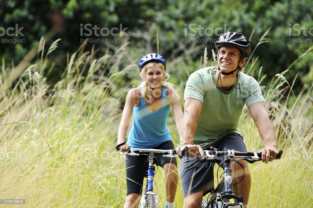 mountainbike couple outdoors stock photo