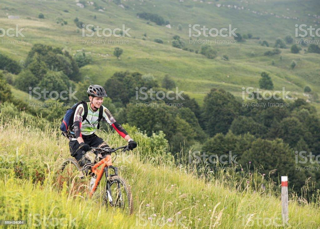 Mountainbike downhill fun in the Julian Alps, Slovenia. stock photo