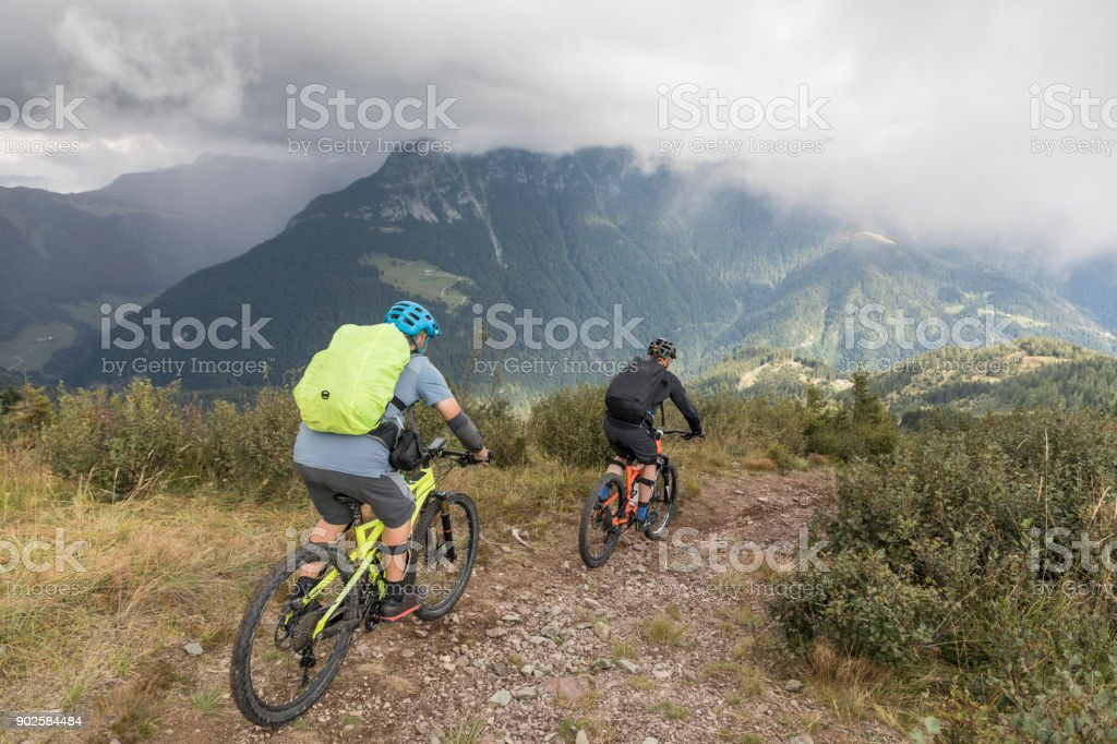 Mountainbike downhill in the misty Friulian Mountains, Italy. stock photo