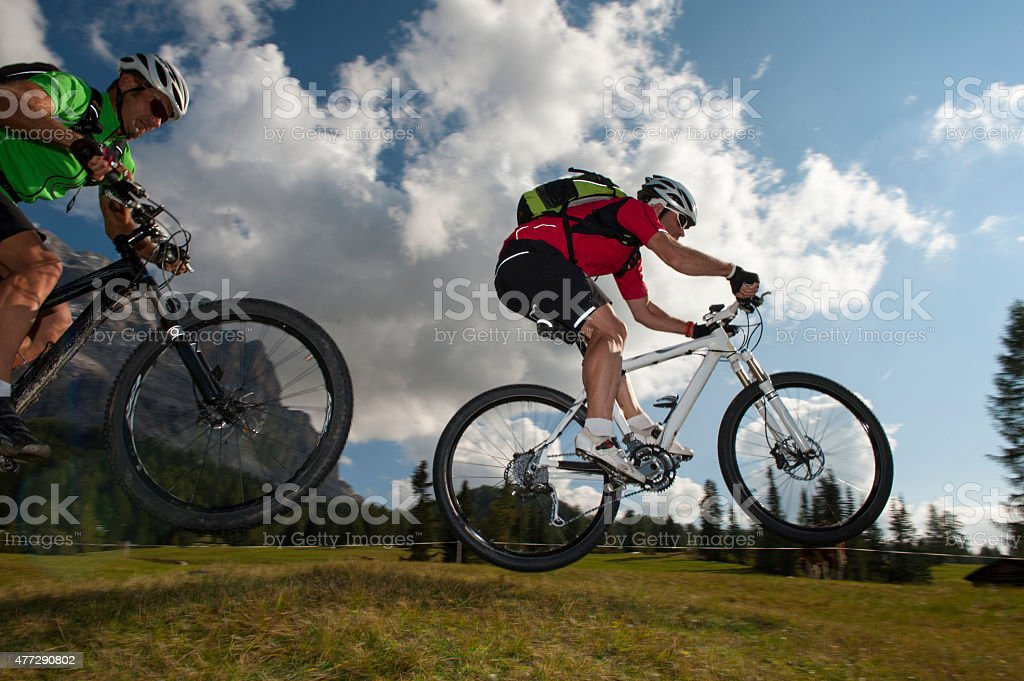 mountainbike downhill jump stock photo